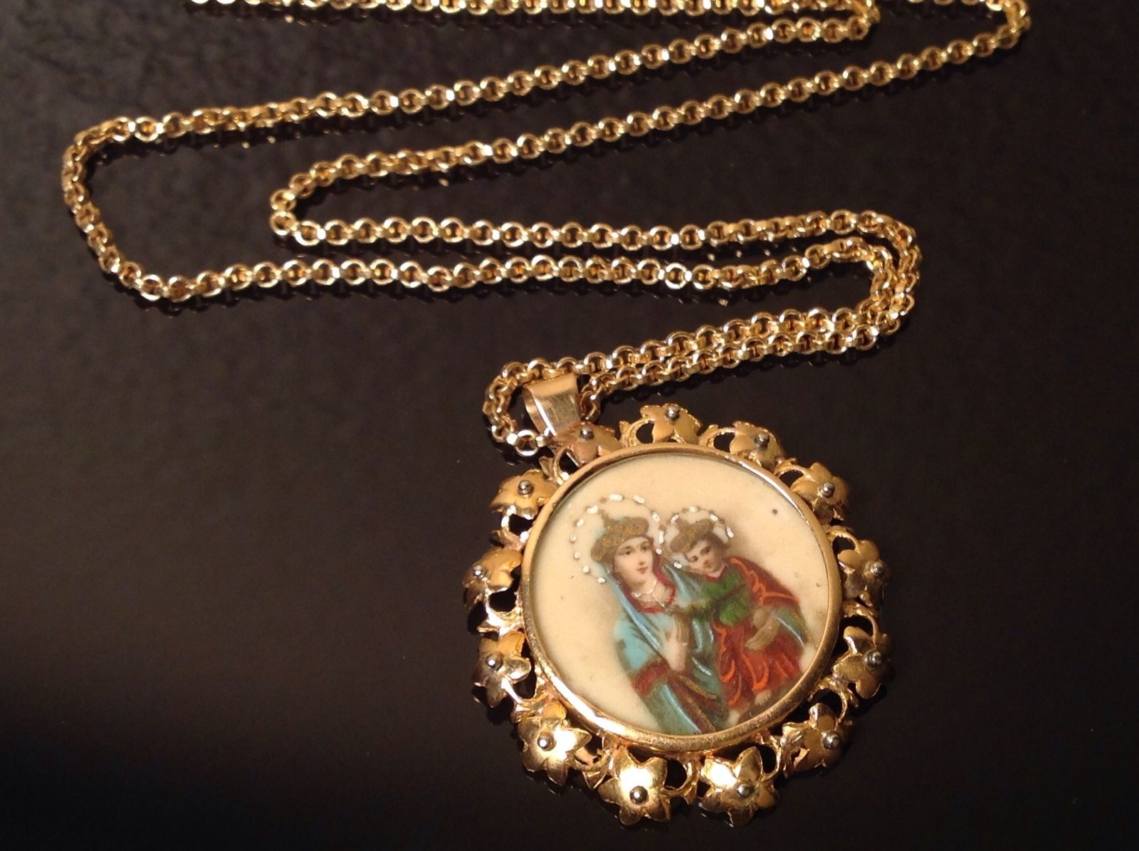 North Africian vintage painted Jesus charm necklace .